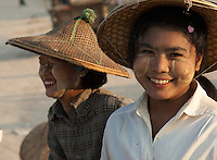 This young woman from the fishing village of Jade Taw on the Bay of Bengal in Myanmar has, like her friend behind her, followed the common Burmese custom of rubbing paste from thanaka bark on her face to protect it from the fierce sun.