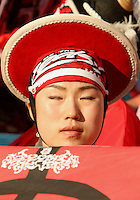 Korean fan meditates before the match. The Korea Republic and France played to a 1-1 tie in their FIFA World Cup Group G match at the Zentralstadion, Leipzig, Germany, June 18, 2006.