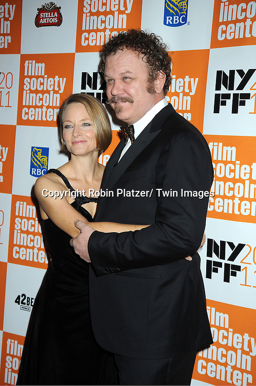 """actress Jodie Foster and John C Reilly attends the 49th Annual New York Film Festival Opening Night Gala presentation of """"Carnage"""" on September 30, 2011 at Alice Tully Hall in New York City."""