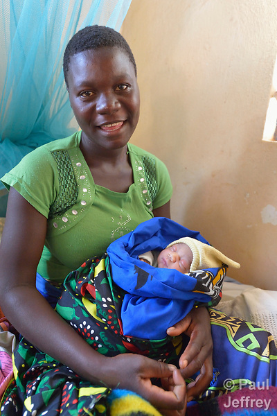 Patricia Phir and her newborn baby boy at the Mhalaunda Health Centre in Mhalaunda, Malawi. The centre, where women from the surrounding countryside come to safely give birth, is supported by the Maternal, Newborn and Child Health program of the Livingstonia Synod of the Church of Central Africa Presbyterian.