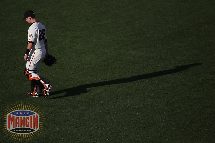 SAN FRANCISCO - OCTOBER 20:  Buster Posey of the San Francisco Giants stretches before Game 4 of the NLCS against the Philadelphia Phillies at AT&T Park on October 20, 2010 in San Francisco, California. (Photo by Brad Mangin)