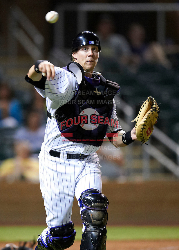 Salt River Rafters catcher Lars Davis #55, of the Colorado Rockies organization, during an Arizona Fall League game against the Mesa Solar Sox at Salt River Fields at Talking Stick on October 9, 2012 in Scottsdale, Arizona.  Salt River defeated Mesa 6-5.  (Mike Janes/Four Seam Images)