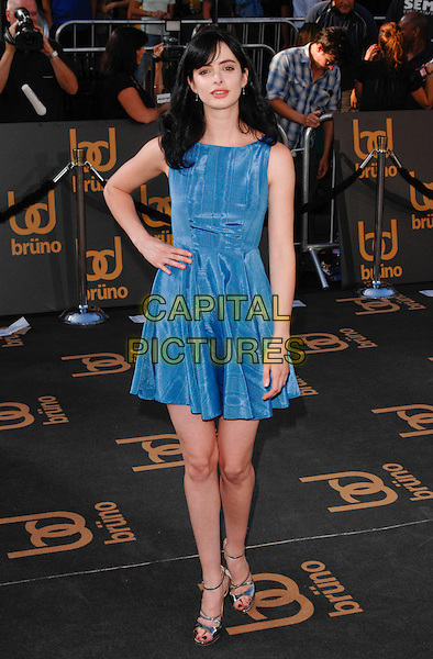 """KRYSTEN RITTER.The American premiere of """"Bruno"""" at Grauman's Chinese Theatre in Hollywood, California, USA.  .June 25th, 2009.full length blue dress sleeveless hand on hip .CAP/ROT.©Lee Roth/Roth Stock/Capital Pictures"""