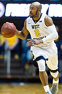 Morgantown, WV - NOV 18, 2017: West Virginia Mountaineers guard Jevon Carter (2) brings the ball up court  during game between West Virginia and Morgan State at WVU Coliseum Morgantown, West Virginia. (Photo by Phil Peters/Media Images International)