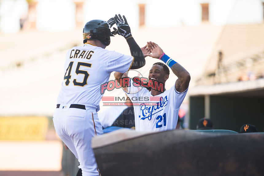 Surprise Saguaros center fielder Nick Heath (21), of the Kansas City Royals organization, congratulates Will Craig (45), of the Pittsburgh Pirates organization, after his first inning home run during an Arizona Fall League game against the Glendale Desert Dogs at Surprise Stadium on November 13, 2018 in Surprise, Arizona. Surprise defeated Glendale 9-2. (Zachary Lucy/Four Seam Images)