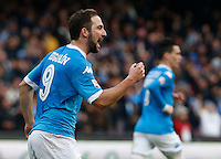 Napoli's Gonzalo Higuain celebrates after scoring during the  italian serie a soccer match,between SSC Napoli and Empoli      at  the San  Paolo   stadium in Naples  Italy , January 31, 2016