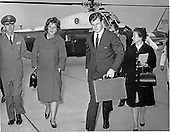 "Camp Springs, MD - (FILE) -- United States Senator Edward M. ""Ted"" Kennedy (Democrat of Massachusetts), carries his briefcase as he arrives at Andrews Air Force Base in Maryland to await the arrival of Air Force One carrying the body of his brother, the late President John F. Kennedy, from Dallas, Texas on November 22, 1963.  Kennedy's wife, Joan, is assisted by a military officer at left..Credit: Arnie Sachs / CNP"