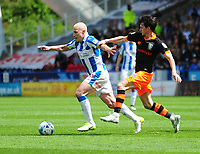 Huddersfield Town's Aaron Mooy vies for possession with Sheffield Wednesday's Kieran Lee<br /> <br /> Photographer Andrew Vaughan/CameraSport<br /> <br /> The EFL Sky Bet Championship Play-Off Semi Final First Leg - Huddersfield Town v Sheffield Wednesday - Saturday 13th May 2017 - The John Smith's Stadium - Huddersfield<br /> <br /> World Copyright &copy; 2017 CameraSport. All rights reserved. 43 Linden Ave. Countesthorpe. Leicester. England. LE8 5PG - Tel: +44 (0) 116 277 4147 - admin@camerasport.com - www.camerasport.com