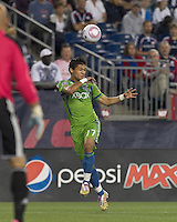 Seattle Sounders forward Fredy Montero (17) heads the ball. In a Major League Soccer (MLS) match, the Seattle Sounders FC defeated the New England Revolution, 2-1, at Gillette Stadium on October 1, 2011.