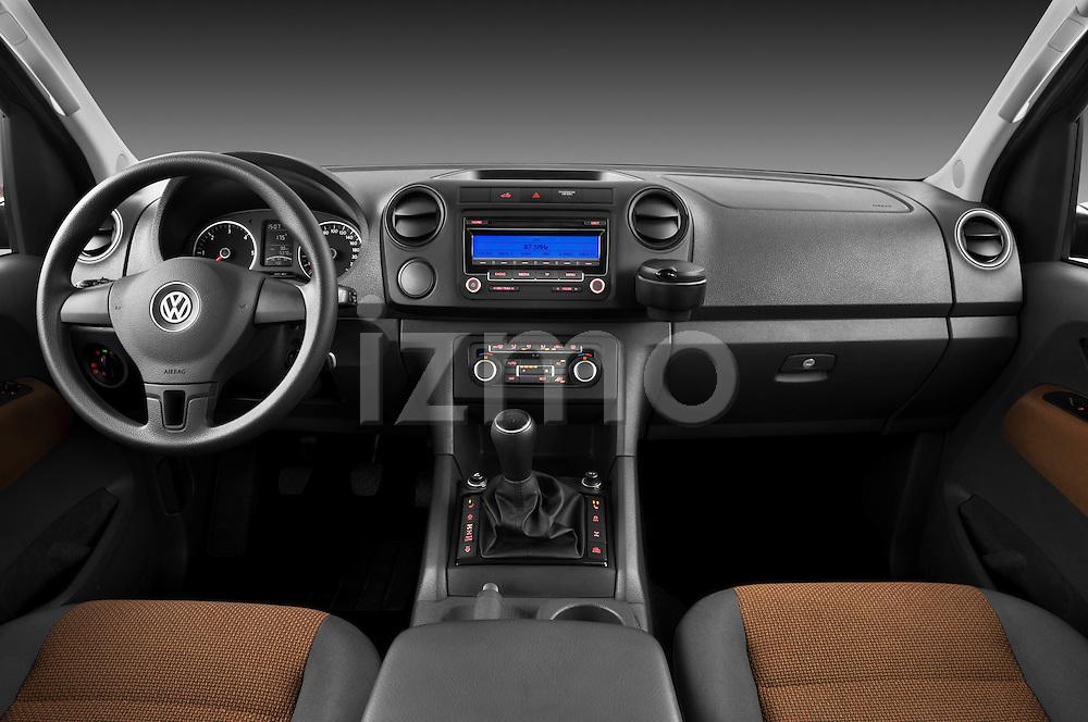 Straight dashboard view of a 2012 Volkswagen Amarok Trendline Truck.