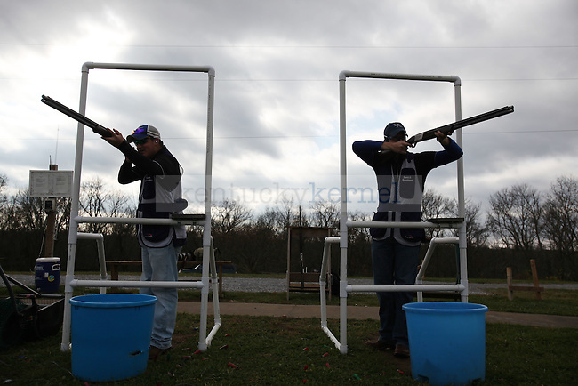 UK Trap and Skeet president Daniel Birkenhauer and Vice President of sporting clays, Cyrus Alexander shoot their guns on Thursday, Nov. 19, 2009 at the Bluegrass Sportsman League in Wilmore, Ky