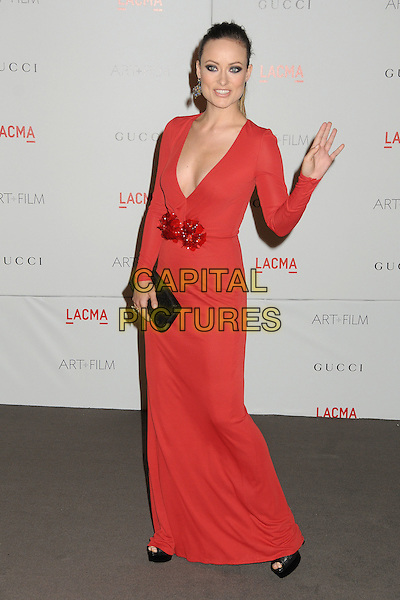 Olivia Wilde.The Inaugural Art and Film Gala held at LACMA in Los Angeles, California, USA..November 5th, 2011.full length dress red low cut neckline cleavage black clutch bag corsage hand waving.CAP/ADM/BP.©Byron Purvis/AdMedia/Capital Pictures.