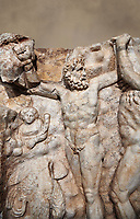 Detail of a Roman Sebasteion relief sculpture of Zeus and Prometheus, Aphrodisias Museum, Aphrodisias, Turkey.   Against an art background.<br /> <br /> Prometheus is screaming in pain. Zeus had given him a terrible punishment for giving fire to man: he was tied to the Caucasus mountains and had his liver picked out daily by an eagle. Herakles shot the eagle and is undoing the first manacle. He wears his trade mark lion-skin and thrown his club to one side. A small mountain nymph, holding a throwing stick appears amongst the rocks.