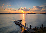 Idaho, North, Kootenai County, Coeur d'Alene. Sunset over Lake Coeur d'Alene, with Tubbs Hill upper right.