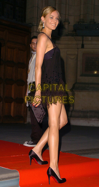 DIANE KRUGER.The In Style 5th Birthday party at Victoria and Albert Museum, London, UK. .June 19, 2006 .Ref: CAN.full length black dress clutch bag shoes.www.capitalpictures.com.sales@capitalpictures.com.©Capital Pictures