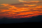 Roger Crowley / CrowleyPhotos.com..A summer sunset shines on the Green Mountains of Vermont. Camel's Hump can be seen on the left. White Rock and Hunger Mts. are on the right..