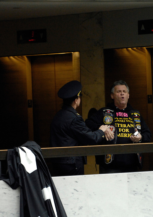 Protesters are removed from the 5th floor of the Hart Senate Office Building by U.S. Capitol Hill Police after they hung anti-war banners from the hand rails in the upper floor atrium.