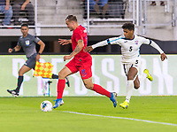 WASHINGTON, DC - OCTOBER 11: Jordan Morris #11 of the United States sprints past Daniel Morejon #5 of Cuba during a game between Cuba and USMNT at Audi Field on October 11, 2019 in Washington, DC.
