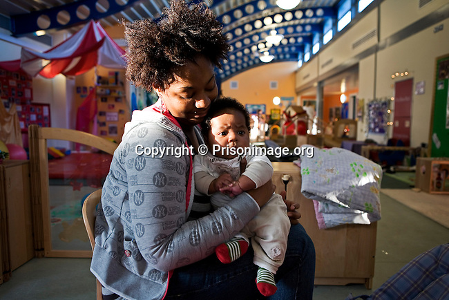 A female prisoner with her 3 month old baby in the mother and baby unit. HMP/YOI Askham Grange is a women's open prison serving the Yorkshire area with a capacity of 128 women. It has extensive education, training and mother and Baby facilities.