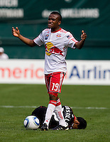 Christian Castillo (12) of D.C. United lies on the ground after being fouled by Dane Richards (19) of the New York Red Bulls at RFK Stadium in Washington, DC.  The New York Red Bulls defeated D.CC United, 2-0.
