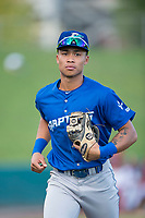 Ogden Raptors third baseman Marcus Chiu (13) jogs off the field between innings of a Pioneer League game against the Orem Owlz at Home of the OWLZ on August 24, 2018 in Orem, Utah. The Ogden Raptors defeated the Orem Owlz by a score of 13-5. (Zachary Lucy/Four Seam Images)