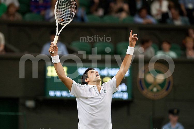 Novak Djokovic (SRB) celebrates after winning the match against Olivier Rochus (BEL). The Wimbledon Championships 2010 The All England Lawn Tennis & Croquet Club  Day 1 Monday 21/06/2010