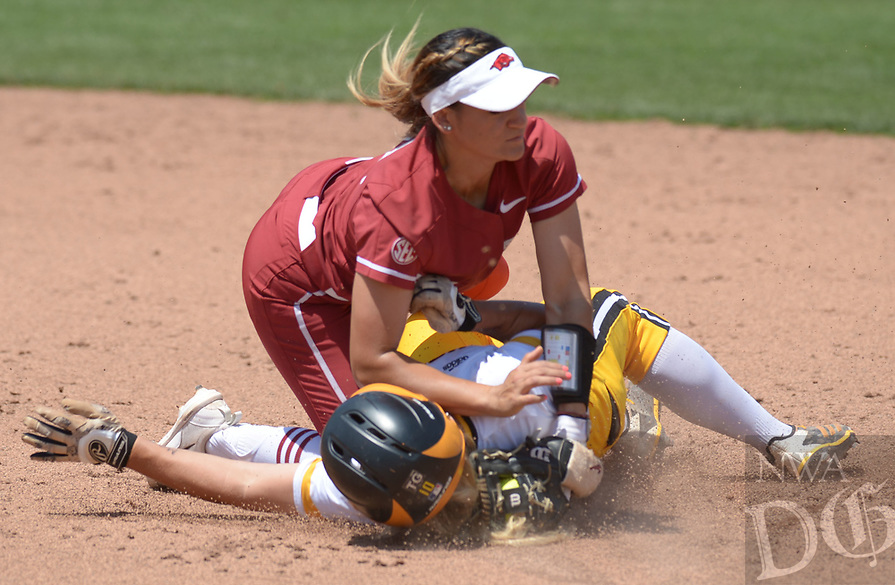 NWA Democrat-Gazette/ANDY SHUPE<br />Arkansas second baseman Haydi Bugarin (top) collides with Wichita State third baseman Mackenzie Wright Saturday, May 19, 2018, as Wright comes in safely at the bag during the third inning at Bogle Park during the NCAA Fayetteville Softball Regional on the university campus in Fayetteville. Visit nwadg.com/photos to see more photographs from the game.