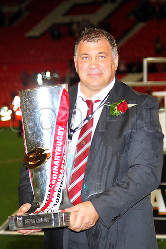 05.10.2013 Manchester, England.Shaun Wane the Head Coach of Wigan Warriors  celebrates with the Super League Trophy after beating Warrington Wolves at the Super League Grand Final between Wigan Warriors and Warrington Wolves from Old Trafford.