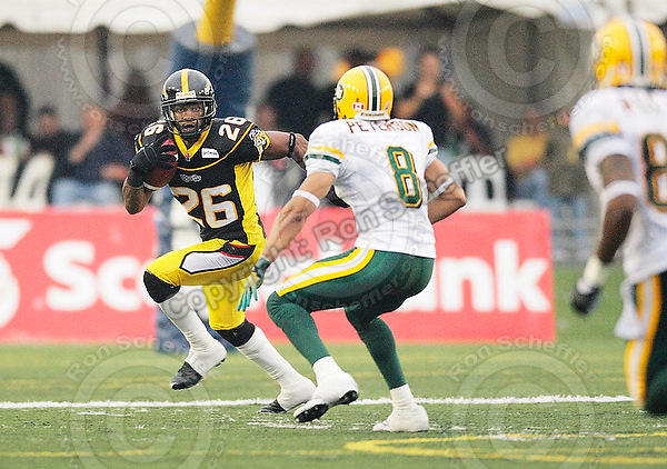 August 8, 2009; Hamilton, ON, CAN; Hamilton Tiger-Cats defensive back Chris Thompson (26) returns an interception, which he lateralled to defensive back Geoff Tisdale (9) for a touchdown. CFL football: Edmonton Eskimos vs. Hamilton Tiger-Cats at Ivor Wynne Stadium. The Tiger-Cats defeated the Eskimos 28-21. Mandatory Credit: Ron Scheffler. Copyright (c) 2009 Ron Scheffler.