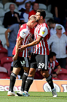 Yoann Barbet congratulates Sergi Canos after scoring Brentford's second goal during Brentford vs Rotherham United, Sky Bet EFL Championship Football at Griffin Park on 4th August 2018