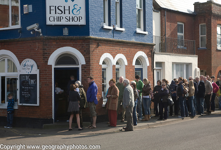 Long queue of people outside chip shop, Aldeburgh, Suffolk, England