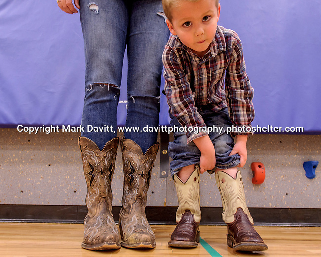 Bondurant hosted a Mother and Son Hoedown March 25 at Anderson Elementary. Everyone had a rootin' tooting' time with lots of snacks, games, crafts, music and dancing too. Bracken Robben pulls his pant legs up to show off his cowboy boots and compare them to his mother' Anastasia Robben's cowgirl boots.