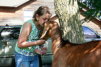 NWA Democrat-Gazette/DAN HOLTMEYER<br /> Ella Kraft, a 10-year-old 4-H member, tends to her Nubian goats at her grandmother's house east of Fayetteville on June 25 in preparation for this year's Washington County Fair. Her family's been raising goats for three generations. Kraft been taking care of goats for as long as she can remember and plans to show six at this year's fair.