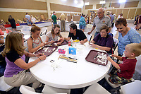 NWA Democrat-Gazette/BEN GOFF @NWABENGOFF<br /> Members of the Bella Vista Woodcarvers Club show guests how to carve using butter knives and bars of soap Saturday, July 15, 2017, during the Bella Vista Woodcarvers Club's Artistry in Wood Show at Bella Vista Assembly of God church. Members of the club exhibited and sold their woodwork at the show, which also included door prizes, demonstrations and a people's choice award.
