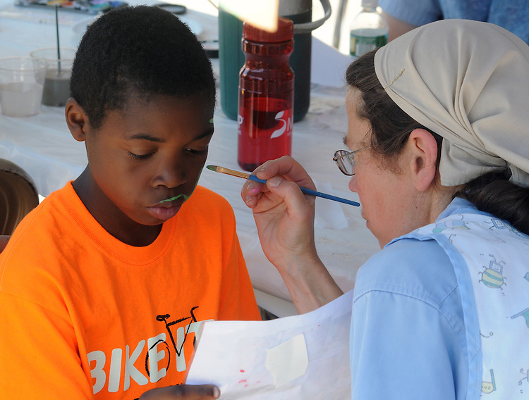 Face Painting provided by members of the Bruderhof community at the 11th Annual Mid-town Make a Difference Day Celebration on Franklin Street, in Kingston, NY on Saturday, June  18, 2016. Photo by Jim Peppler. Copyright Jim Peppler 2016.