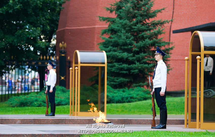 Eternal fire guards at the Tomb of Unknown Soldier in front of the Kremlin wall, Moscow, Russia