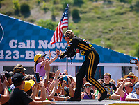 Jun 17, 2018; Bristol, TN, USA; NHRA top fuel driver Leah Pritchett greets fans prior to the Thunder Valley Nationals at Bristol Dragway. Mandatory Credit: Mark J. Rebilas-USA TODAY Sports