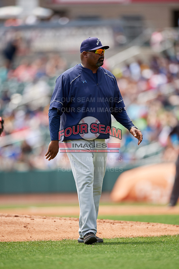 Pensacola Blue Wahoos pitching coach James Baldwin (39) walks back to the dugout during a game against the Birmingham Barons on May 9, 2018 at Regions Field in Birmingham, Alabama.  Birmingham defeated Pensacola 16-3.  (Mike Janes/Four Seam Images)