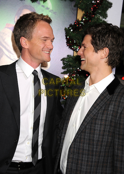 Neil Patrick Harris & David Burtka.'A Very Harold & Kumar 3D Christmas' Los Angeles premiere, Grauman's Chinese Theatre, Hollywood, California, USA..2nd November 2011.half length suit grey gray black white shirt tie check jacket couple side profile .CAP/ROT/TM.©Tony Michaels/Roth Stock/Capital Pictures