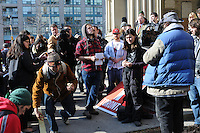 November 15, 2011, a group of Occupy Toronto protesters hold a noon hour general assembly in front of St. James Church to discuss their options following the delivery of an eviction notice, requiring the protestors to vacate St. James Park as of 12:01am, November 16, 2011.