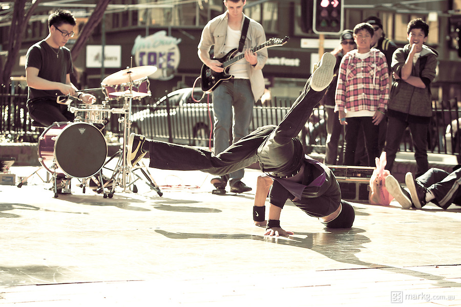A live funk band and break dancers perform on the street during the 2011 Rugby World Cup celebrations in Wellington, New Zealand.