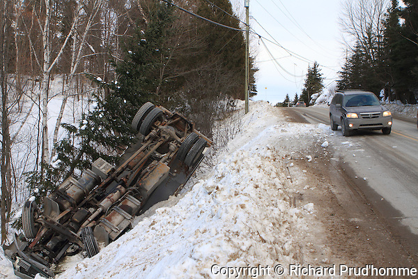 Overturned truck in a ditch