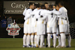 11 December 2009: Akron's starters huddle before the game. The University of Akron Zips defeated the University of North Carolina Tar Heels 5-4 on penalty kicks after the game ended in a 0-0 overtime tie at WakeMed Soccer Stadium in Cary, North Carolina in an NCAA Division I Men's College Cup Semifinal game.