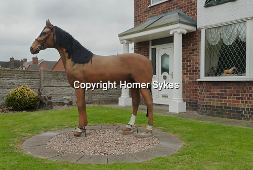 House decoration with fiberglass horse in front garden Leicestershire UK