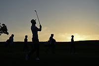 HaoTong Li (CHN) is silhouetted by the early Friday morning sunrise as he watches his approach shot on 10 during day 2 of the Valero Texas Open, at the TPC San Antonio Oaks Course, San Antonio, Texas, USA. 4/5/2019.<br /> Picture: Golffile | Ken Murray<br /> <br /> <br /> All photo usage must carry mandatory copyright credit (© Golffile | Ken Murray)