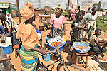 Sisiwe Luhana (center) sells her donuts in an outdoor market in Ekwendeni, Malawi. She benefits from receiving credit from a community loan fund sponsored by the Church of Central Africa Presbyterian.