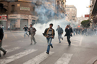Protesters march through the streets of central Cairo amidst tear gas fired by the police. Continued anti-government protests take place in Cairo calling for President Mubarak to stand down. After dissolving the government, Mubarak still refuses to step down from power.