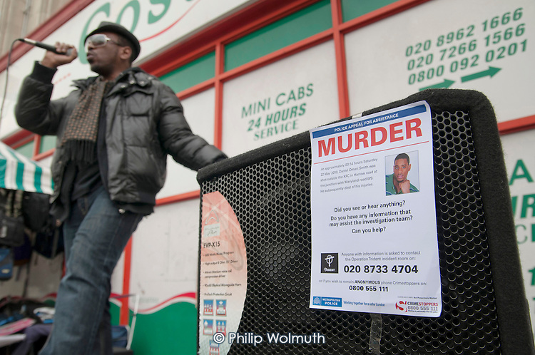 Singer Noel McKoy, Community Rally organised by the Tell It Parents' Action Group to launch a campaign aimed at addressing the problem of gang violence in North Westminster.  Police poster appealing for witnesses to the murder, in a drive-by shooting, of Daniel Omari Smith on the Harrow Road in May 2010.