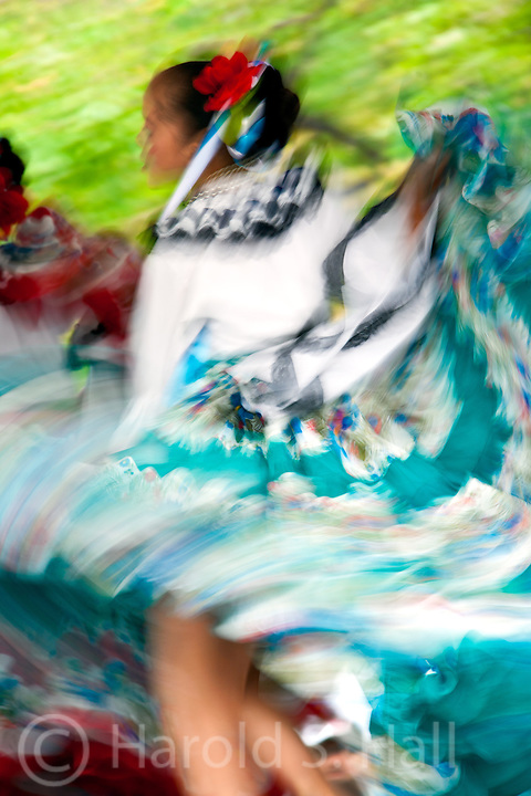 An Indian girl dances to celebrate in the Santa Fe Plaza