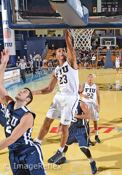 Florida International University guard Marco Porcher Jimenez (23) plays against Nova Southeastern University.  Nova won the game 77-59 on December 3, 2013 at Miami, Florida.